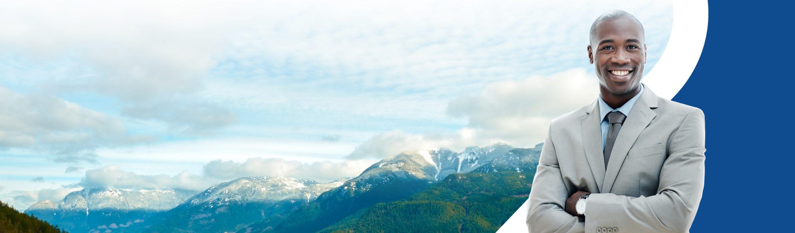 Professional man standing next to British Columbia scenery